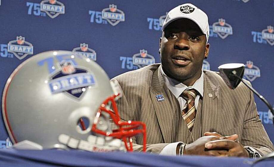 Texas defensive tackle Lamarr Houston responds to questions during a news interview after he was selected as the 44th overall pick by the Oakland Raiders  in the second round of the NFL football draft at Radio City Music Hall Friday, April 23, 2010, in New York. Photo: Frank Franklin II, AP