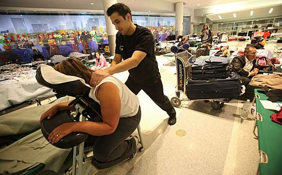 NEW YORK - APRIL 20:  Anthony Riera gives free massages to stranded passengers inside John F. Kennedy International Airport following flight disruptions due to volcanic activity in Iceland April 20, 2010 in the Queens borough of New York City. Many European flights resumed for the first time in days but chaos continued as a backlog of flights grows and London's airports remained closed. Photo: Mario Tama, Getty Images