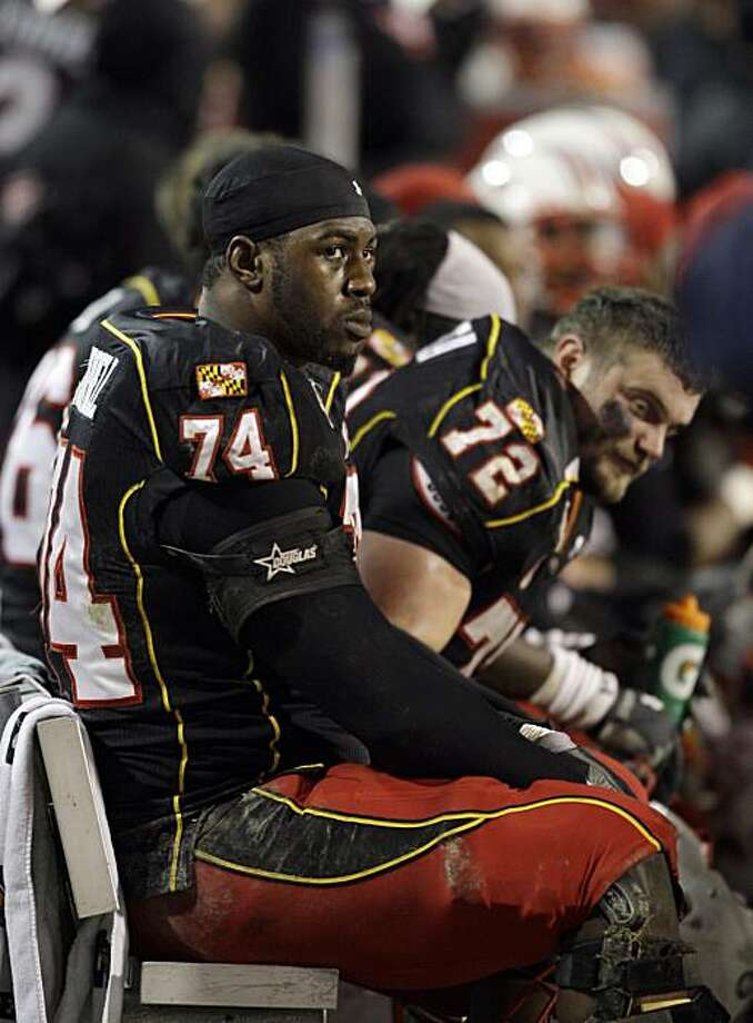 Maryland offensive linemen Bruce Campbell (74) and Phil Costa (72) sit on the bench during the closing moments of their 19-17 loss to Boston College during an NCAA college football game, Saturday, Nov. 28, 2009, in College Park, Md.  (AP Photo/Rob Carr) Photo: Rob Carr, AP