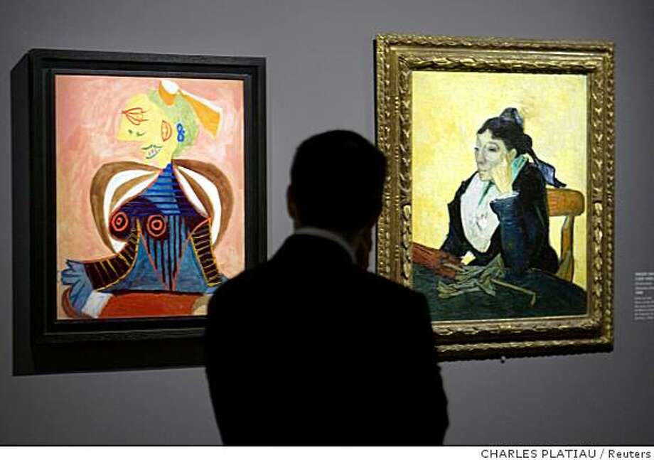 "A visitor looks at a painting (L) by Spanish artist Pablo Ruiz Picasso ""Portrait of Lee Miller"" next to "" Madame Ginoux "" by Vincent van Gogh exhibited at the Grand Palais Museum in Paris October 6, 2008. The exhibition ""Picasso and the Masters"" opens to the public on September 26, 2008 and runs until February 2, 2009. REUTERS/Charles Platiau  (FRANCE) Photo: CHARLES PLATIAU, Reuters"