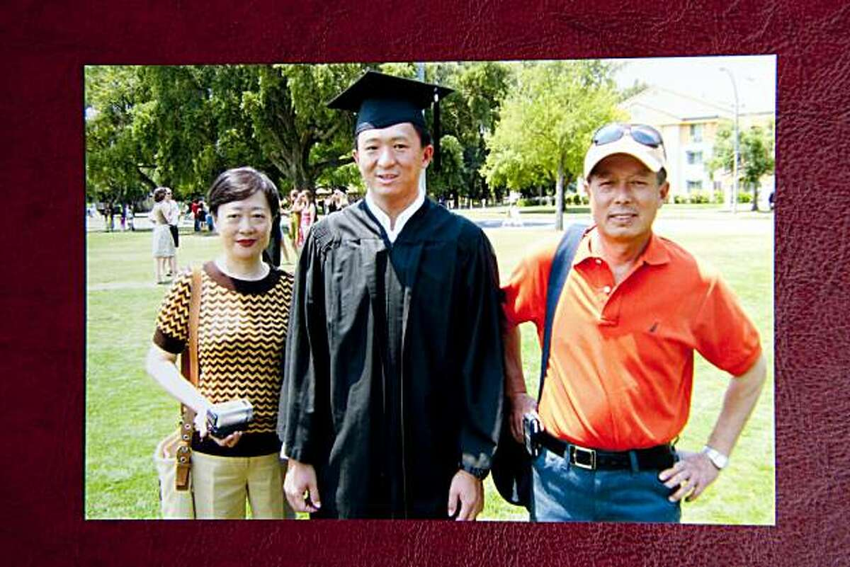 Jin Cheng Yu, center, is seen with his father, Tian Sheng Yu, right, and mother Zhi Rui Wang, left, in this family photo from Jin's UC Davis graduation in 2008. Jin and his father were beaten by attackers on Friday in Oakland.