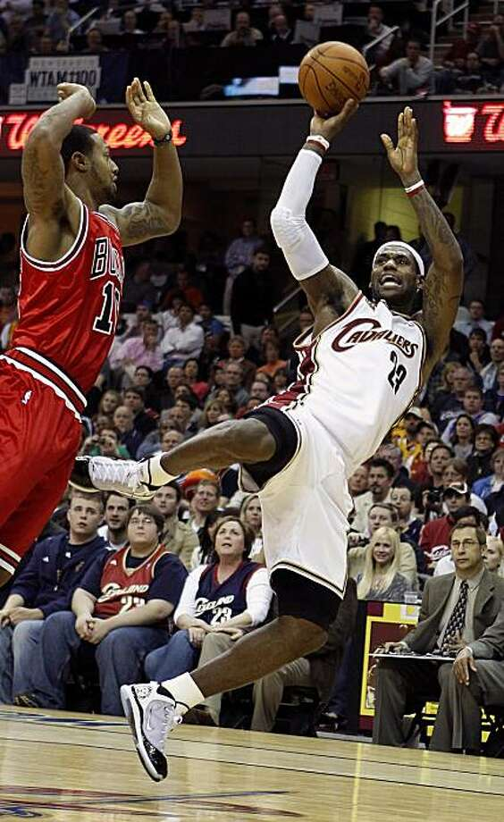 CLEVELAND - APRIL 19:  LeBron James #23 of the Cleveland Cavaliers shoots over James Johnson #16 of the Chicago Bulls in Game Two of the Eastern Conference Quarterfinals during the 2010 NBA Playoffs at Quicken Loans Arena on April 19, 2010 in Cleveland, Ohio.  NOTE TO USER: User expressly acknowledges and agrees that, by downloading and or using this photograph, User is consenting to the terms and conditions of the Getty Images License Agreement. Cleveland won the game 112-102 to take a 2-0 series lead. Photo: Gregory Shamus, Getty Images
