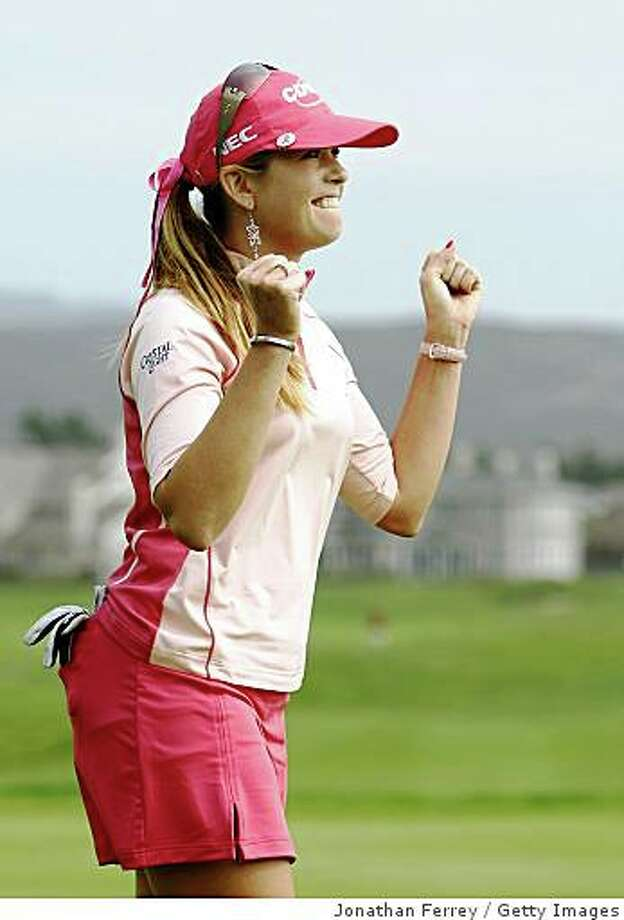 HALF MOON BAY, CA - OCTOBER 05:  Paula Creamer pumps her fist on the 18th hole after winning during the final round of the Samsung World Championship at the Half Moon Bay Golf Links Ocean Course on October 5, 2008 in Half Moon Bay, California.  (Photo by Jonathan Ferrey/Getty Images) Photo: Jonathan Ferrey, Getty Images