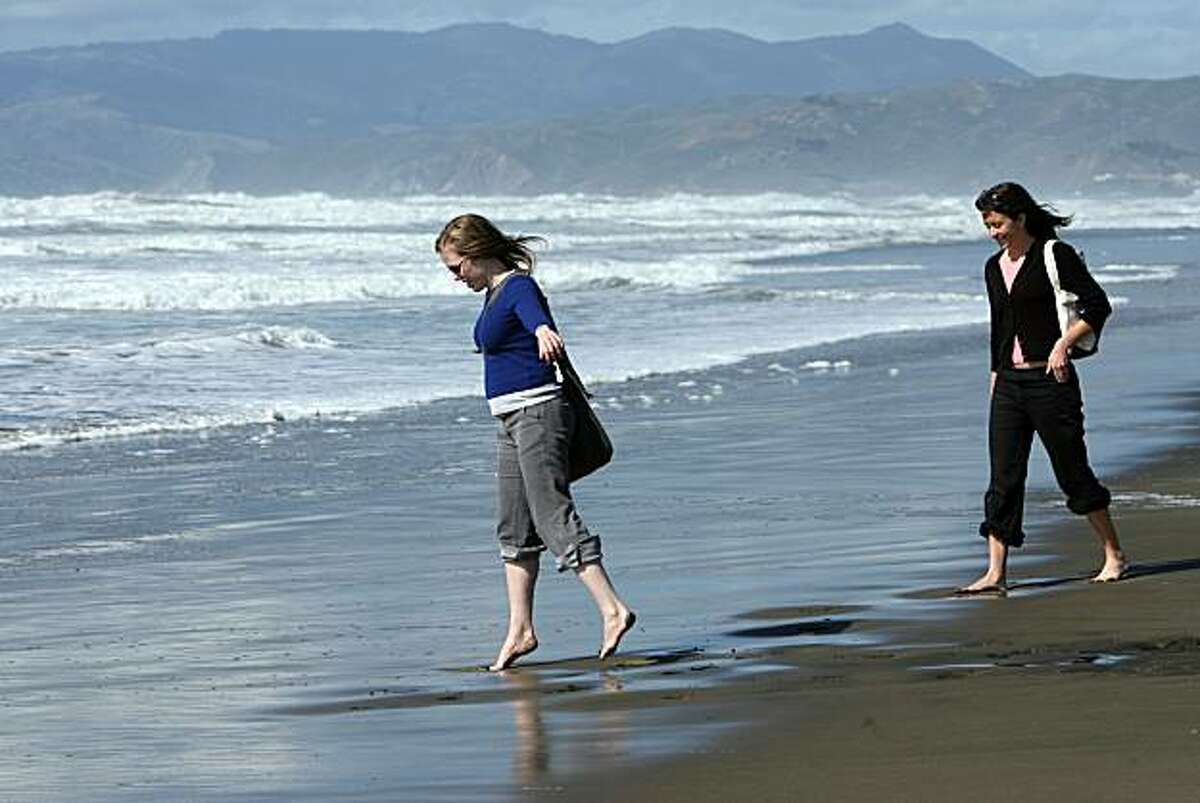 Alicia has lunch and a walk on Ocean Beach with friend Kate Anderson. They have been friends since high school. Together today to mark one year of knowing she has cancer. Photo taken on 3/3/06, in San Francisco, CA.