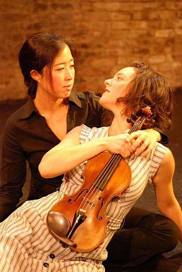 "The Fiddler (Rebecca Jackson, left) uses a fiddle made from the bones of the dead Sarah (Jenna Bean Veatch, left) in Claytie Mason's ""The Wind and Rain"" Photo: Bryan Thomas"