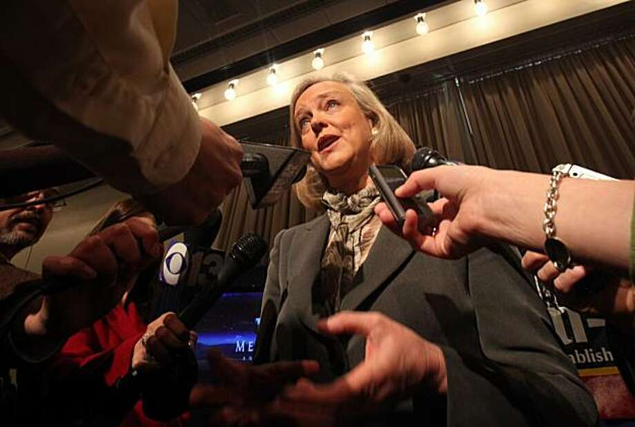 In this photo taken Tuesday, March 23, 2010, Republican gubernatorial candidate Meg Whitman talks with reporters after appearing at the California Taxpayers Association meeting in Sacramento, Calif.  Whitman insists that, if elected, can save California money by eliminating 40,000 state government jobs.  However, the governor has authority over just 57 percent of the state work force, with the rest of the employees working in departments not completely beholden to the state's general fund. Photo: Rich Pedroncelli, AP