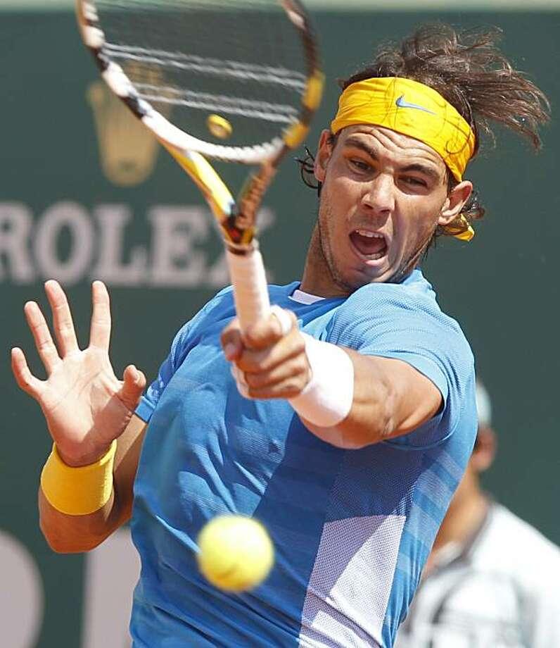 Spain's Rafael Nadal returns a shot to Spain's Fernandao Verdasco during their final match of the Monte Carlo Tennis Masters tournament, in Monaco, Sunday, April 18, 2010. Photo: Claude Paris, AP