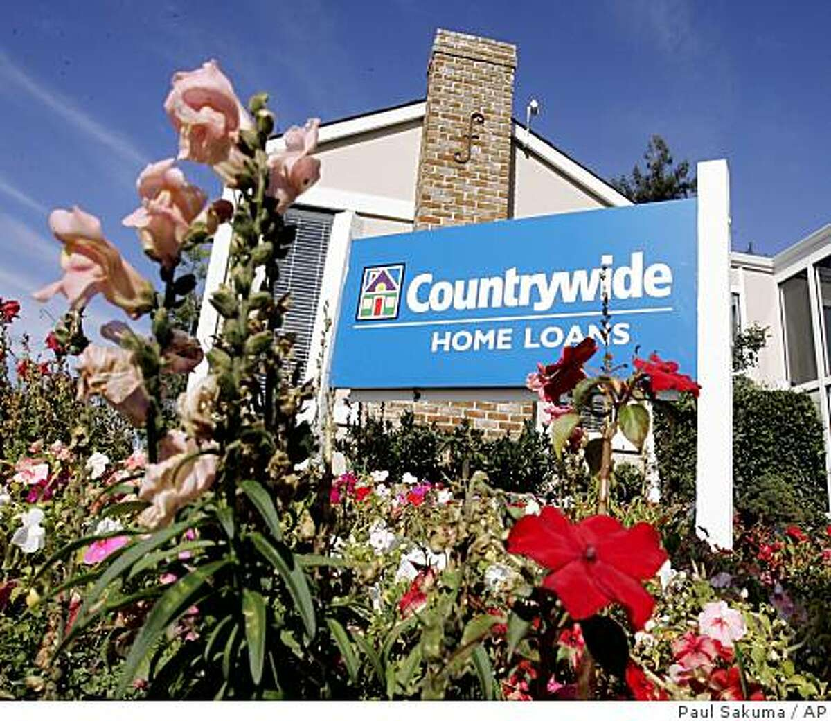 ** FILE ** The exterior view of a Countrywide banking and loan office in San Mateo, Calif. is seen in this Oct. 26, 2007 file photo. Countrywide Financial Corp.'s shares tumbled for the second day Wednesday, Jan. 9, 2008, after the nation's largest mortgage lender said the delinquency and foreclosure rate of home loans in its portfolio surged in December. The news drove Countrywide shares down almost 10 percent in midday trading. (AP Photo/Paul Salkuma, file)