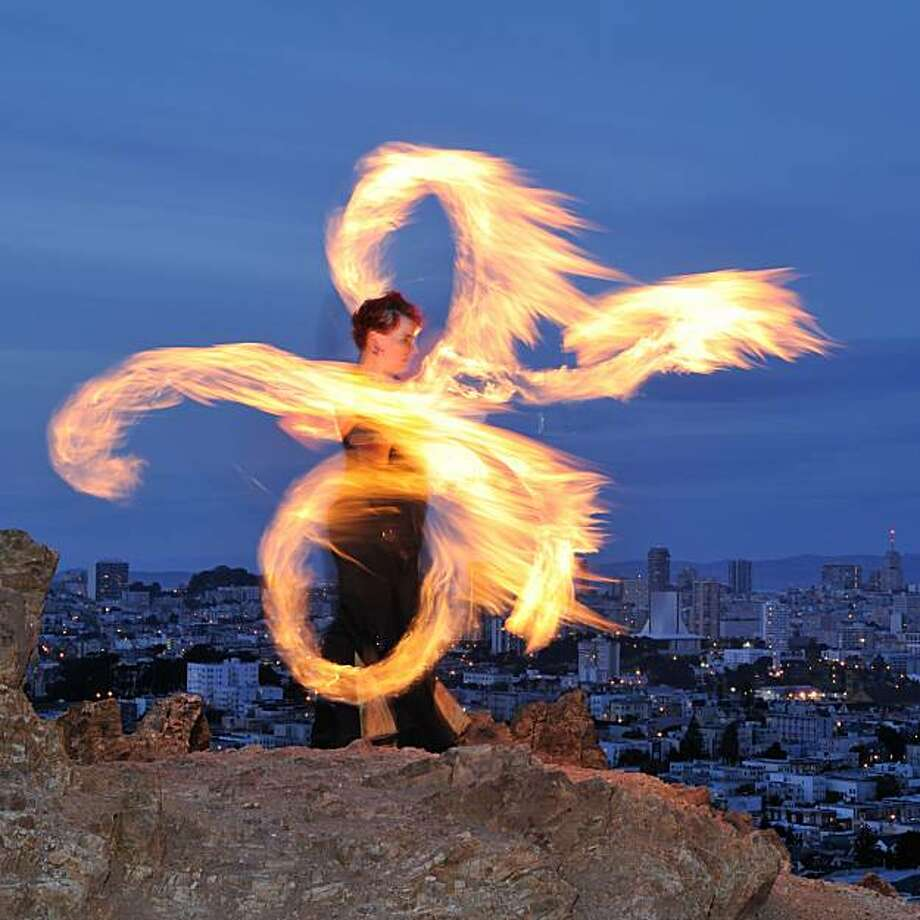 Temple of Poi's Fire Dancing Expo at Union Square on  Saturday night is part of Bay Area National Dance week, with hundreds of events throughout the region. Photo: Waldemar Horwat