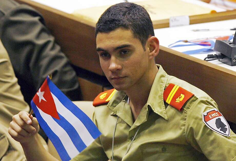FILE - In this April 4, 2010 file photo, Elian Gonzalez holds a Cuban flag during the Union of Young Communists congress in Havana, Cuba. Gonzalez, the Cuban boy at the center of an international custody battle 10 years ago in April 2000, attended Cuba'sYoung Communist Union wearing an olive green military school uniform. Photo: Ismael Francisco, AP