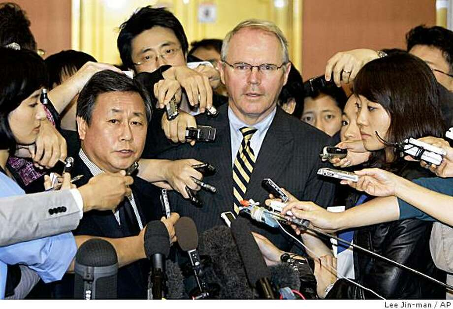 U.S. nuclear envoy Christopher Hill, center right, and his South Korean counterpart Kim Sook, center left, listen to reporters' questions after their meeting at Foreign Ministry in Seoul, South Korea, Friday, Oct. 3, 2008. The chief U.S. envoy at six-nation talks on North Korea's nuclear disarmament met with Kim Sook Friday after spending three days in the North trying to persuade it to resume dismantling its nuclear program. (AP Photo/ Lee Jin-man) Photo: Lee Jin-man, AP