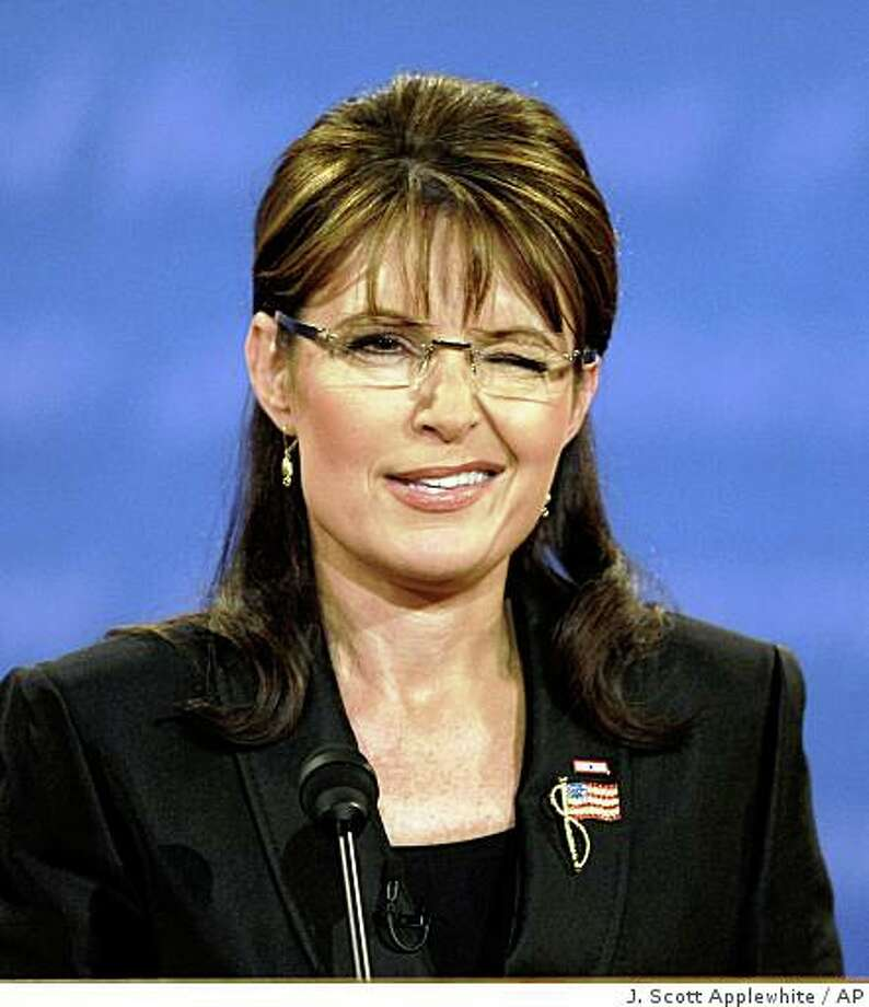 Republican vice presidential candidate Alaska Gov. Sarah Palin winks as she speaks during her vice presidential debate against Democratic vice presidential candidate Sen. Joe Biden, D-Del., at Washington University in St. Louis, Mo., Thursday, Oct. 2, 2008.  (AP Photo/J. Scott Applewhite) Photo: J. Scott Applewhite, AP