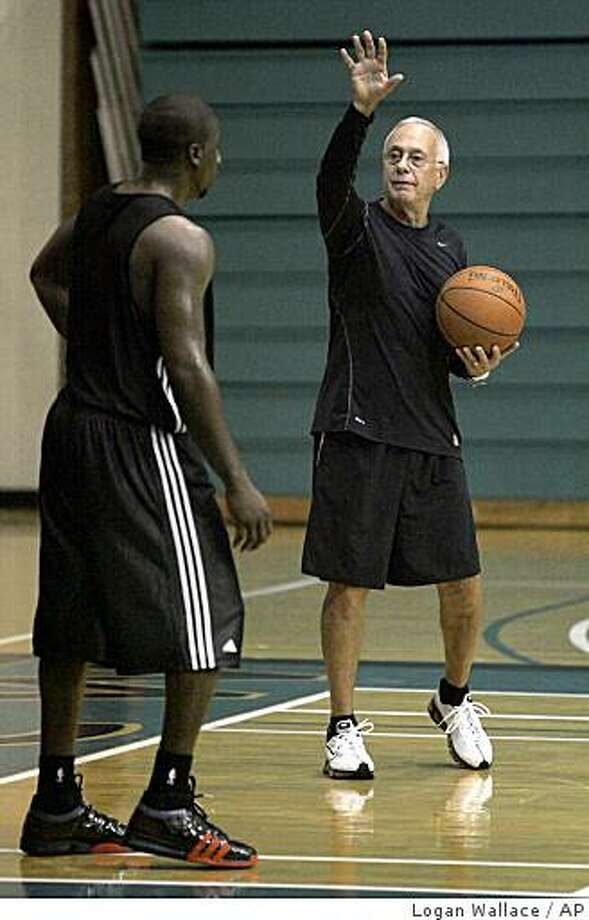 Charlotte Bobcats' coach Larry Brown, right, works with a player during basketball training camp at UNC-Wilmington, Tuesday, Sept. 30, 2008 in Wilmington, N.C.  (AP Photo/Logan Wallace) Photo: Logan Wallace, AP