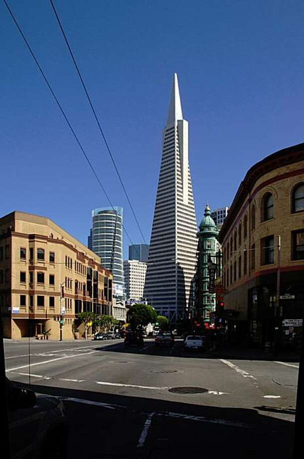 An artist's rendering of the proposed condominium tower at 555 Washington St., which is on the same block as the Transamerica Pyramid, as seen from Columbus Avenue.  The tower would be double the current height limit and cast shadows on two protected citAn artist's rendering of the proposed condominium tower at 555 Washington St., which is on the same block as the Transamerica Pyramid, as seen from Columbus Avenue.  The tower would be double the current height limit and cast shadows on two protected city-owned parks. Photo: Courtesy, Heller Manus Architects