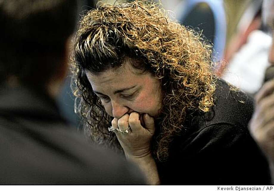 Sharon Aikens widow of train crash victim Chris Aikens is emotional during a town hall-style meeting organized by Hildebrand McLeod & Nelson LLP law firm Tuesday Sept. 30, 2008. in nSimi Valley,Calif.,  in the heart of communities most affected when a Metrolink train taking commuters home from Los Angeles collided with a freight train. Lawyers have begun campaigns to represent victims of the Sept. 12 Metrolink commuter train wreck that killed 25 people and injured more than 130 others in suburban Los Angeles. (AP Photo/Kevork Djansezian) Photo: Kevork Djansezian, AP