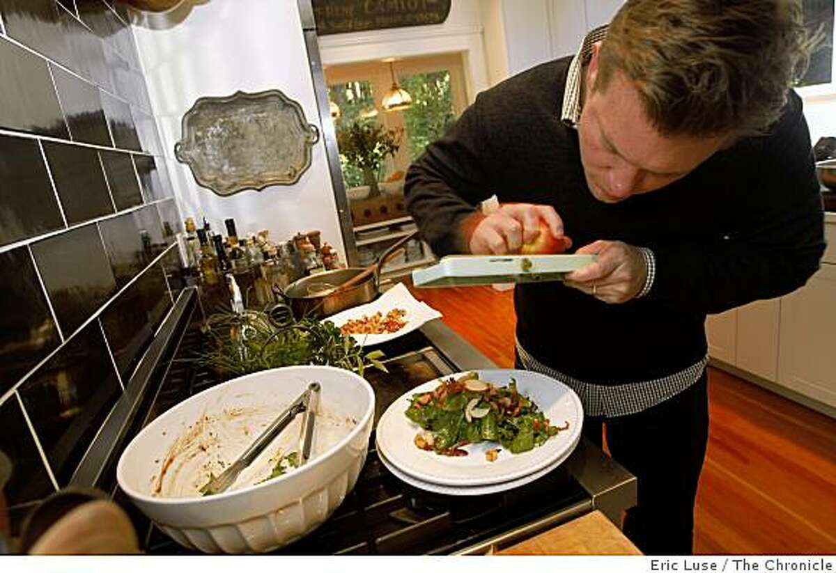 Tyler Florence crafts a salad in their remodeled kitchen in Mill Valley.