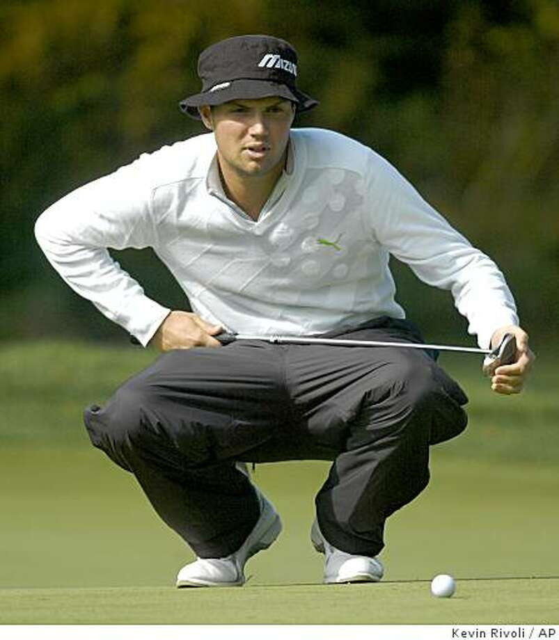 Jeff Overton lines up his putt on the 16th green during the second round of the Turning Stone Resort Championship in Verona, N.Y., Friday, Oct. 3, 2008. Photo: Kevin Rivoli, AP