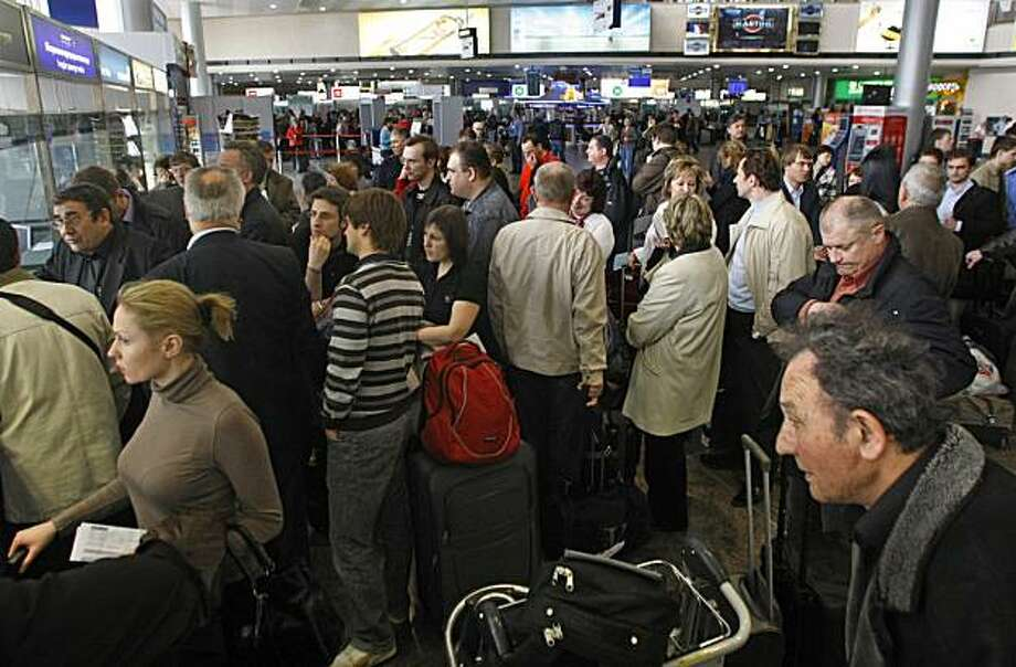 Passengers queue at a ticket office to change or return their tickets at a departure terminal in Sheremetyevo airport, near Moscow, Saturday, April 17, 2010. A lingering volcanic ash plume forced extended no-fly restrictions over much of Europe Saturday,as Icelandic scientists warned that volcanic activity had increased and showed no sign of abating _ a portent of more travel chaos to come. Photo: Mikhail Metzel, AP