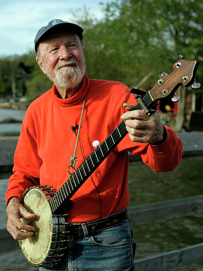 ** FILE ** In this May 5, 2006 file photo, folk singer Pete Seeger plays his banjo on May 5, 2006, in Beacon, N.Y.   (AP Photo/Frank Franklin II) Photo: Frank Franklin II, AP / ONLINE_CHECK