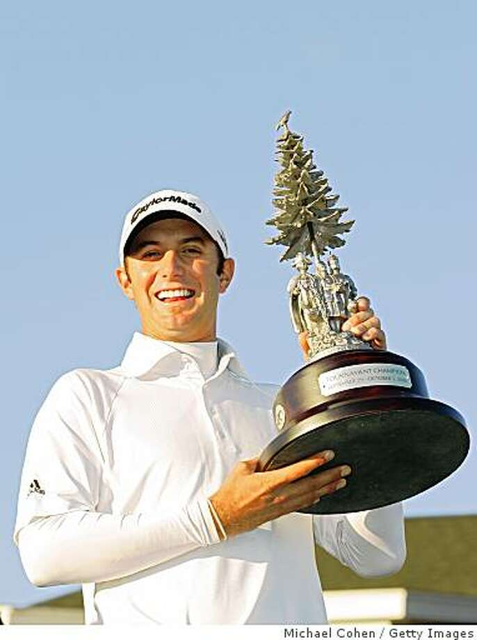 Dustin Johnson poses with the trophy after winning the Turning Stone Resort Championship at Atunyote Golf Club on October 5, 2008 in Verona, New York. Photo: Getty Images