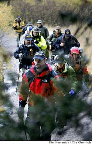 Searchers hike to the site of a plane crash in  Mammoth Lakes, Calif., on Thursday, Oct. 2, 2008. Searchers found the wreckage of Steve Fossett's plane in California's rugged Sierra Nevada just over a year after the millionaire adventurer vanished on a solo flight, and the craft appears to have hit the mountainside head-on, authorities said. (AP Photo/San Francisco Chronicle, Kim Komenich) **NO SALES MAGS OUT MANDATORY CREDIT** Photo: Kim Komenich, The Chronicle