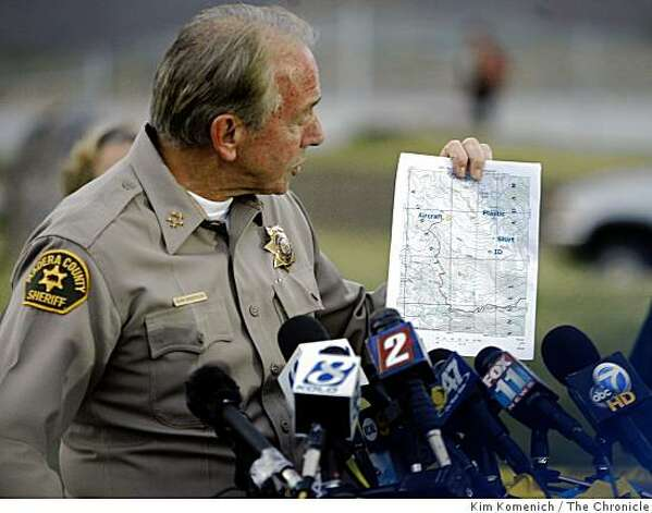 At a press conference at the Mammoth Lakes Airport on Thursday, Oct. 2, 2008, Madera, Calif,  County Sheriff John Anderson holds a topographic map of the area where searchers began to recover the wreckage of a small airplane in Devil's Postpile National Monument near Mammoth Lakes, Calif. The plane is  believed to be the one flown by billionaire Steve Fossett when he disappeared on September 3, 2007. Photo: Kim Komenich, The Chronicle