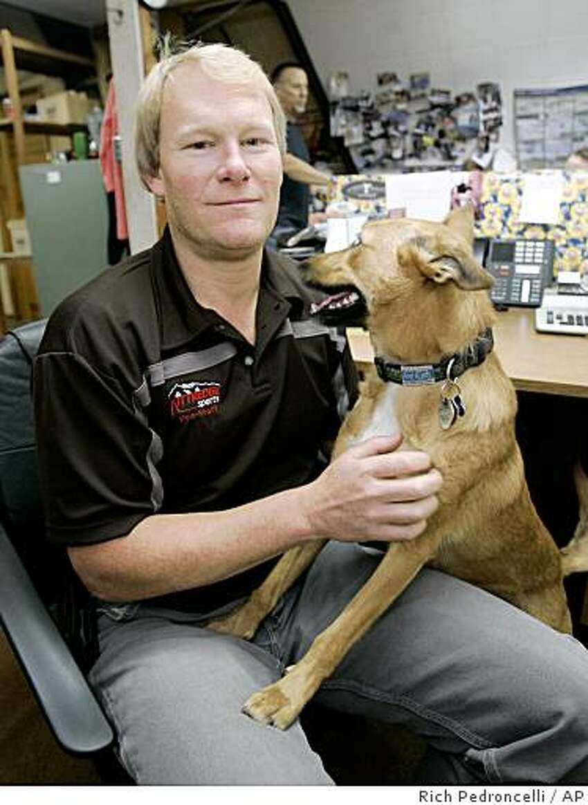 Preston Morrow who discovered some items belonging to missing adventurer Steve Fossett, is seen with his dog Kona at the Kittredge Sports where he works in Mammoth Lakes, Calif., Wednesday, Oct. 1, 2008. Morrow was hiking with Kona, Monday, when he discovered the Federal Aviation Administration identity card, pilot's license and a third ID and $1,005 in cash west of the town of Mammoth Lakes.(AP Photo/Rich Pedroncelli)