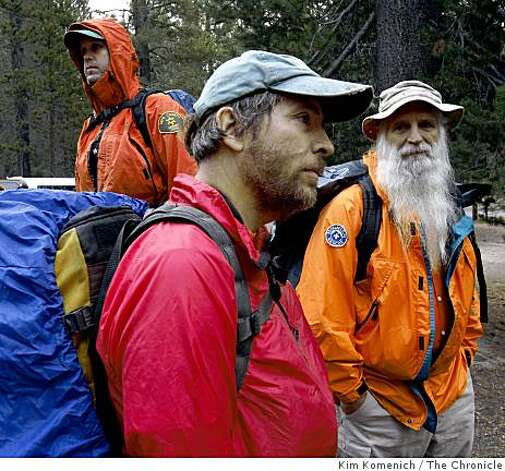 Dave German, 49, of Bishop, Calif., foreground, and colleagues from the Inyo County Search and Rescue Team pause before beginning the 3-4 hour hike into the crash site of a small airplane in Devil's Postpile National Monument near Mammoth Lakes, Calif., on Thursday, Oct. 2, 2008. The plane is  believed to be the one flown by billionaire Steve Fossett when he disappeared on September 3, 2007. Photo: Kim Komenich, The Chronicle