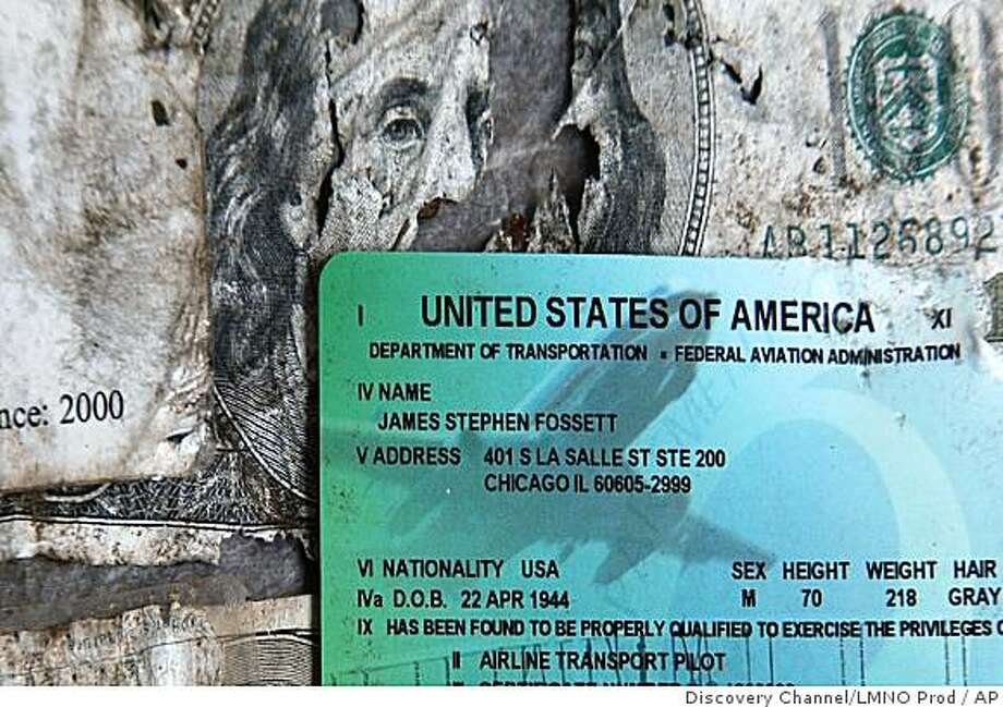 This image made from video taken by Discovery Channel/LMNO Productions shows a pilot's license and a torn $100 bill found Monday, Sept. 29, 2008 by hiker Preston Morrow in a rugged part of eastern California. Morrow found the license and other items that appear to belong to Steve Fossett, the adventurer who vanished on a solo flight more than a year ago, authorities said Wednesday, Oct. 1, 2008. (AP Photo/Discovery Channel/LMNO Productions) Photo: Discovery Channel/LMNO Prod, AP