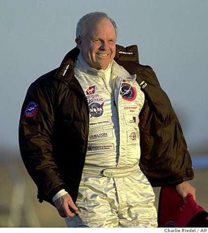 ** FILE ** In this Feb. 28, 2005 photo, pilot Steve Fossett walks across a windy runway to the GlobalFlyer at the Salina Municipal Airport in Salina, Kan. Authorities in rugged eastern California say a hiker has found items possibly belonging to Fossett who disappeared Sept. 3, 2007, after taking off in a single-engine plane borrowed from a Nevada ranch owned by hotel magnate Barron Hilton. (AP Photo/Charlie Riedel, File) Photo: Charlie Riedel, AP