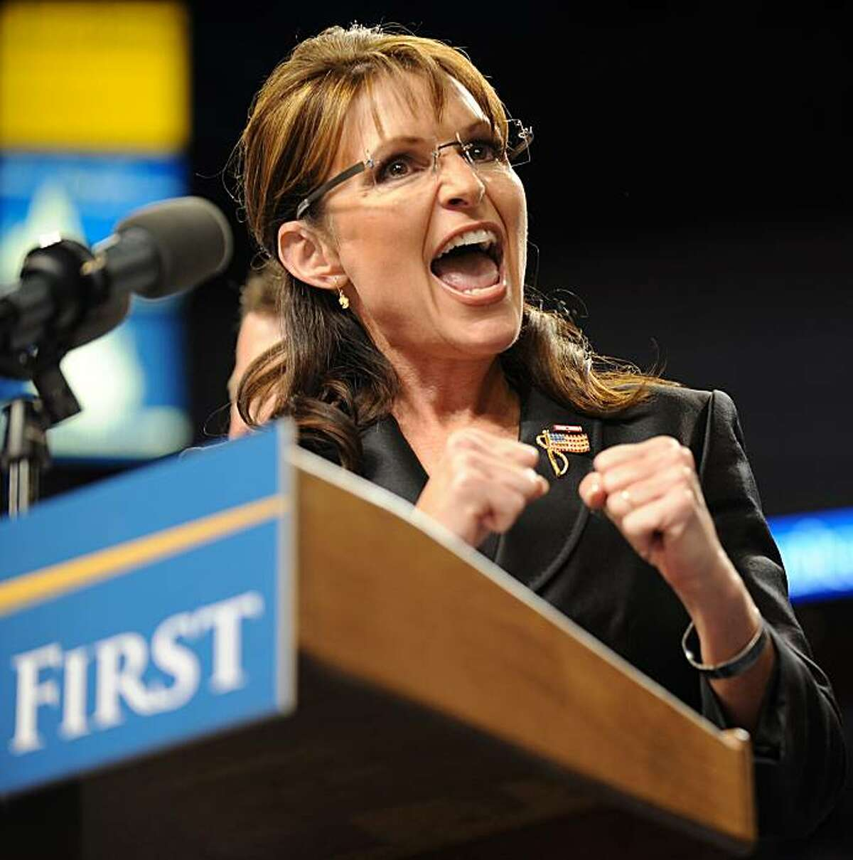Republican vice presidential candidate Sarah Palin responds to cheers upon her arrival for a post-debate rally at St. Louis University's Chaifetz Arena in St. Louis, Missouri on October 02, 2008. Palin received a rock-star welcome at the rally after holding her own in a highly-anticipated US vice presidential debate with Democrat Joseph Biden. AFP PHOTO / Robyn BECK (Photo credit should read ROBYN BECK/AFP/Getty Images)
