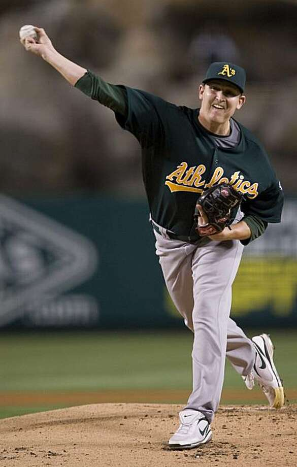 Oakland Athletics starting pitcher Trevor Cahill throws against the Los Angeles Angels during the first inning of a baseball game in Anaheim, Calif., Thursday, Aug. 27, 2009. (AP Photo/Chris Carlson) Photo: Chris Carlson, AP