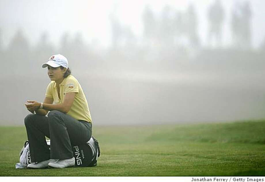 HALF MOON BAY, CA - OCTOBER 02:  Lorena Ochoa waits to hit during a delay in play due to thick fog on the second hole during the first round of the Samsung World Championship at the Half Moon Bay Golf Links Ocean Course on October 2nd, 2008 in Half Moon Bay, California.  (Photo by Jonathan Ferrey/Getty Images) Photo: Getty Images