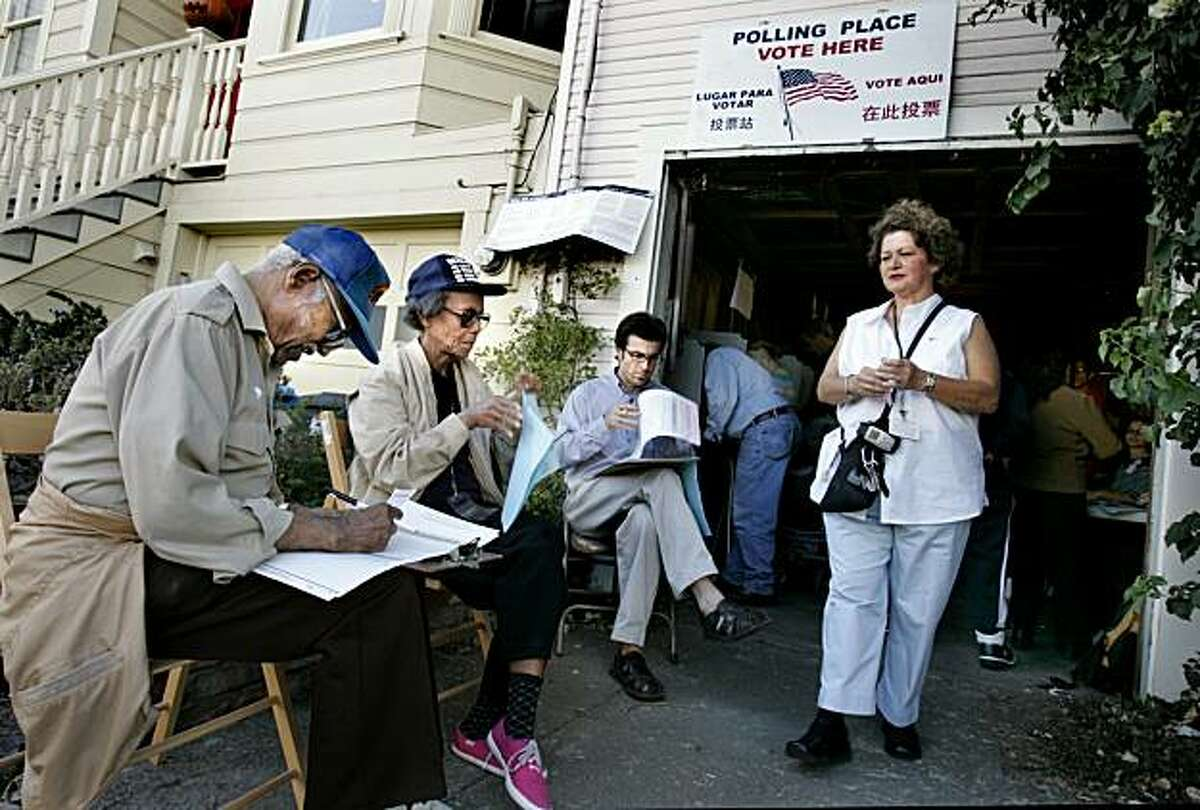 In the San Francisco system of an instant runoff, which took effect in 2004, voters rank their top three candidates and if no one gets a majority, officials eliminate the last-place candidate and redistribute his or her second-place votes. The process continues until someone tops 50 percent. San Francisco voters turn out. SHOWN: Voters in 2004, at the polling place at 210 Banks St. in Bernal Heights there are not enough booths, so with federal permission polling volunteers set out chairs. Alice and Herbert Cross, sitting on the far left, complete their ballots. Gilda Serrano walks out of the polling place, having filled out her ballot on a neighbor's steps.