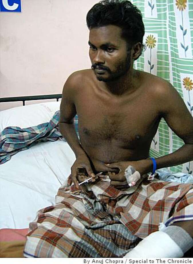 T. Selvaraj, 29, a grocery store owner, injects himself with insulin while recuperating from an ulcer on his leg at a hospital in Chennai, India. Selvaraj suffers from Type 2 diabetes. Photo: By Anuj Chopra, Special To The Chronicle