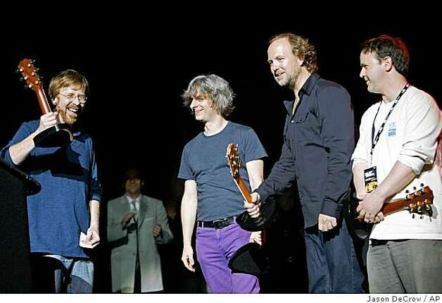 ** FILE ** In this May 7, 2008 file photo, members of the band Phish, from left, Trey Anastasio, Mike Gordon, Page McConnell and Jon Fishman are honored at the seventh annual Jammy awards at the Theater at Madison Square Garden in New York.  (AP Photo/Jason DeCrow, file) Photo: Jason DeCrow, AP
