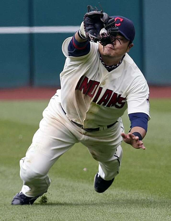Cleveland Indians right fielder Shin-Soo Choo catches a fly ball hit by Chicago White Sox's Gordon Beckham in the ninth inning of a baseball game, Sunday, April 18, 2010, in Cleveland. The Indians won 7-4. Photo: Tony Dejak, AP