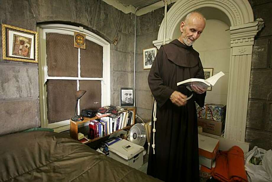 Father Louie lives on the grounds of St. Boniface in a tiny room below the tower...he is busy packing now for his sabbatical.  Father Louie Vitale has been a fixture in the Tenderloin district of San Francisco for decades. Now he is leaving his post at Saint Boniface Church on Golden Gate Avenue and moving on to a new assignment. As one of his last duties, he and another priest performed the annual blessing of the taxis in front of the church. Photo: Brant Ward, The Chronicle
