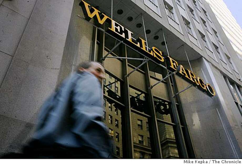A man walks past the Wells Fargo headquarters in the business district on Monday, Sept. 29, 2008 in San Francisco, Calif. Despite tough economic times Wells Fargo has managed maintain financial stability. Photo: Mike Kepka, The Chronicle