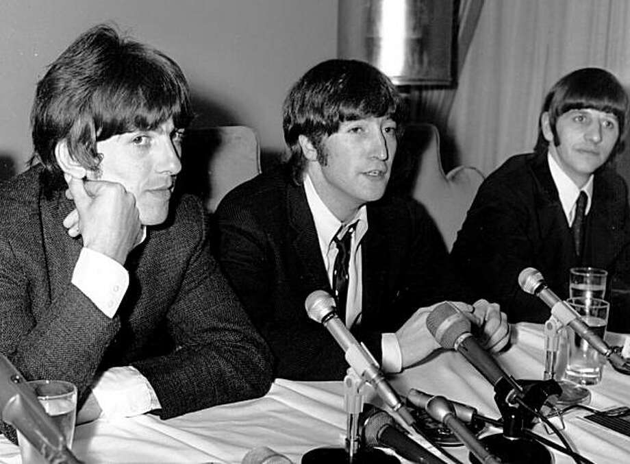 "FILE - In this  Aug. 11, 1966 file photo, John Lennon of the Beatles, center, is flanked by bandmates George Harrison, left, and Ringo Starr as he apologizes for his remark that ""the Beatles are more popular than Jesus,"" at a Chicago news conference. TheVatican newspaper in its weekend editions April 10-11, 2010 said the Beatles' ""dissolute"" lives and John Lennon's boastful claim that the band was more popular than Jesus are in the past, while their music lives on. Photo: AP"