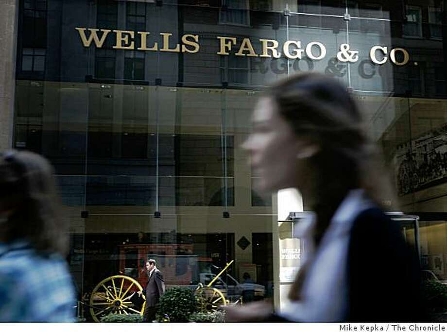 People move past the Wells Fargo stage coach and museum in the business district on Monday, Sept. 29, 2008 in San Francisco, Calif. Despite tough economic times Wells Fargo has managed maintain financial stability. Photo: Mike Kepka, The Chronicle