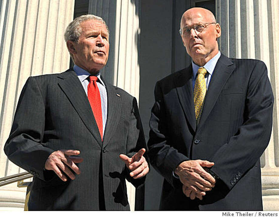 U.S. President George W. Bush (L) stands with Treasury Secretary Henry Paulson, after thanking Treasury workers for their efforts after the House passed the $700 billion financial rescue legislation, outside the Treasury Building in Washington, October 3, 2008.       REUTERS/Mike Theiler  (UNITED STATES) Photo: Mike Theiler, Reuters