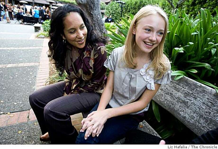 """Actress Dakota Fanning (middle) and director Gina Prince-Bythewood (left) of """"The Secret Life of Bees"""" at the pre-party for the opening night of the 31st Mill Valley film festival at the Outdoor Art Club in Mill Valley,  Calif.,  on Thursday, October 2, 2008. Photo: Liz Hafalia, The Chronicle"""