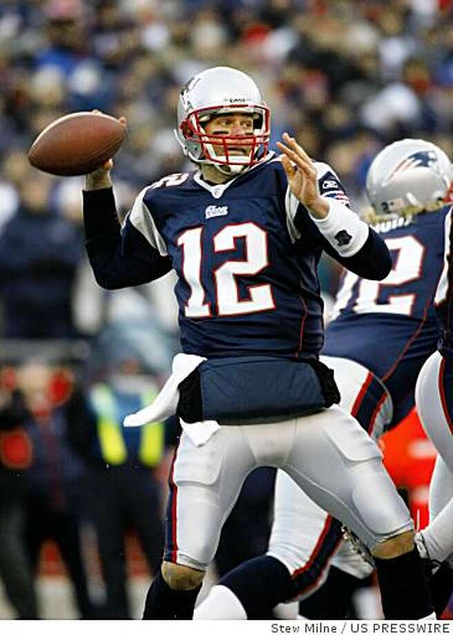 Jan 20, 2007; Foxborough, MA, USA; New England Patriots quarterback Tom Brady (12) throws a pass in the first quarter against the San Diego Chargers during the AFC Championship game at Gillette Stadium.  Mandatory Credit: Stew Milne-US PRESSWIRE Photo: Stew Milne, US PRESSWIRE