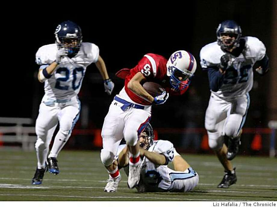 Bellarmine's Mike Dirkson trips up St. Ignatius' MIchael Kennedy during the first half at St. Ignatius High School in San Francisco, Calif., on Friday, October 3, 2008. Kennedy suffered an injury during this play. Photo: Liz Hafalia, The Chronicle