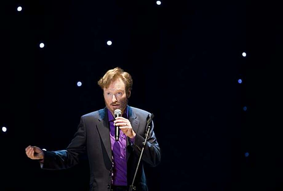 "Comedian Conan O'Brien performs during a stop of ""The Legally Prohibited From Being Funny on Television Tour"" in Vancouver, British Columbia, Tuesday, April 13, 2010. Photo: Jonathan Hayward, AP"