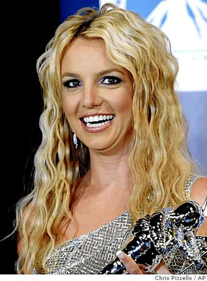 ** FILE ** In this Sept. 7, 2008, file photo, Britney Spears poses with her awards backstage at the 2008 MTV Video Music Awards in Los Angeles. (AP Photo/Chris Pizzello, file) Photo: Chris Pizzello, AP