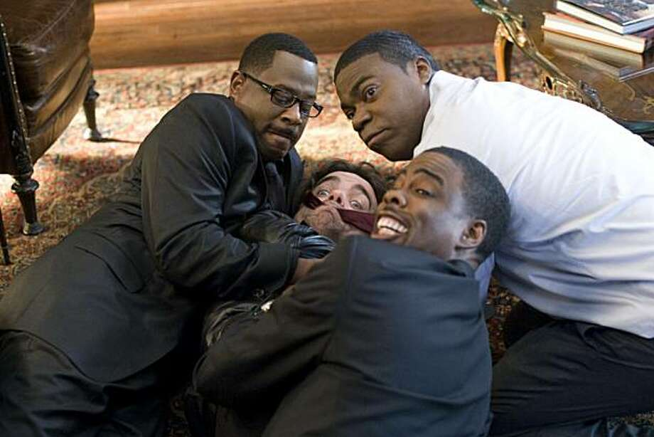 (l to r) Martin Lawrence, Peter Dinklage, Tracy Morgan and Chris Rock star in Screen Gems' comedy DEATH AT A FUNERAL. Photo: Phil Bray, Screen Gems