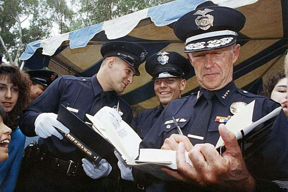 FILE - In this May 29, 1992 file photo, Los Angeles Police Chief Daryl Gates autographs his book for new police officers after their graduation  in Los Angeles. Police say that Gates, who resigned in the wake of 1992 rioting that followed the Rodney Kingbeating, has died. He was 83.  The police department said in a statement that Gates died Friday, April 16, 2010 at his Newport Beach home with his family at his bedside. Photo: Chris Martinez, AP