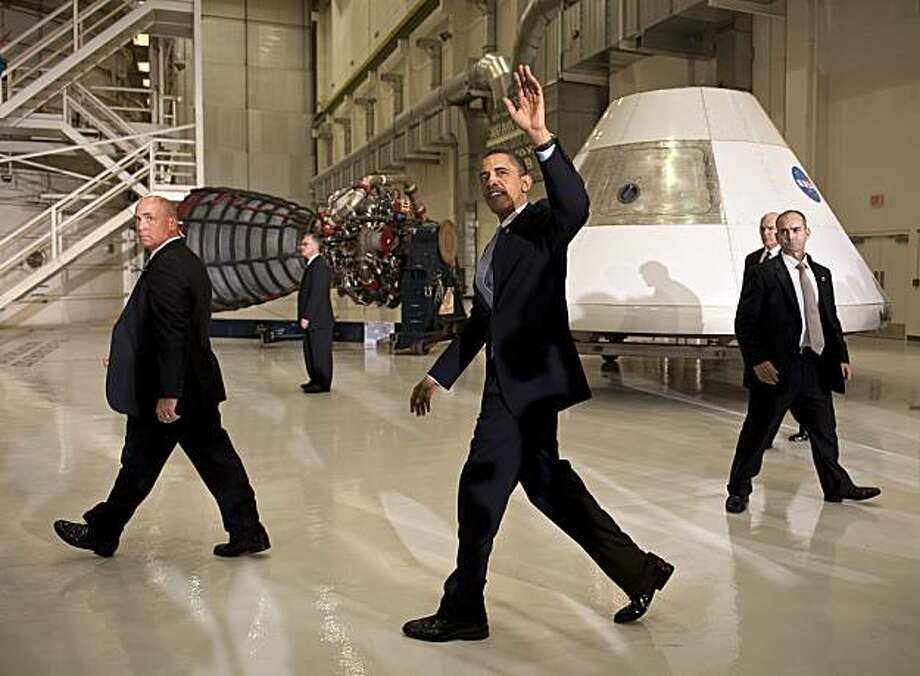 CAPE CANAVERAL, FL -  APRIL 15:  U.S. President Barack (C)Obama waves after speaking at the Operations and Checkout Building at NASA Kennedy Space Center April 15, 2010 in Cape Canaveral, Floridia.  Obama is holding a summit to discuss the future of the space program. Photo: Bill Ingalls, Getty Images